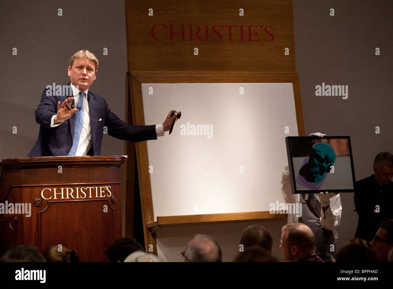 Image shows an Auctioneer taking bids at Christie's Auction house, Old Bond Street, London, UK. Photo:Jeff Gilbert - Stock Image