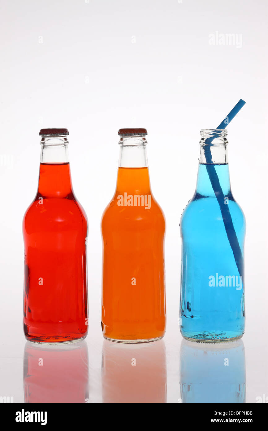 Bottles of colorful soda - Stock Image