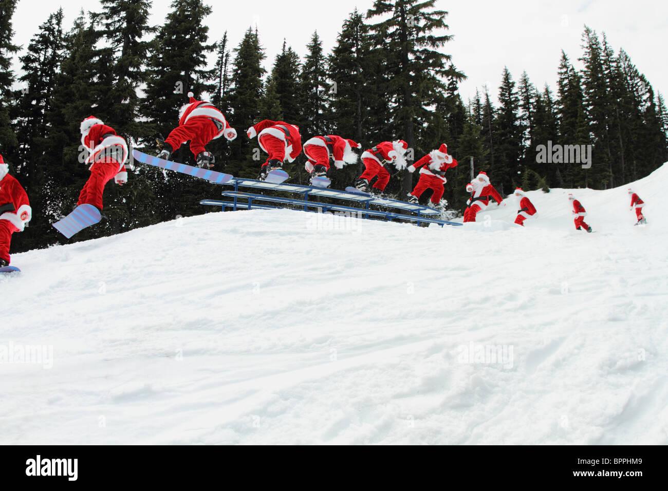 Santa claus snowboarding sequence - Stock Image
