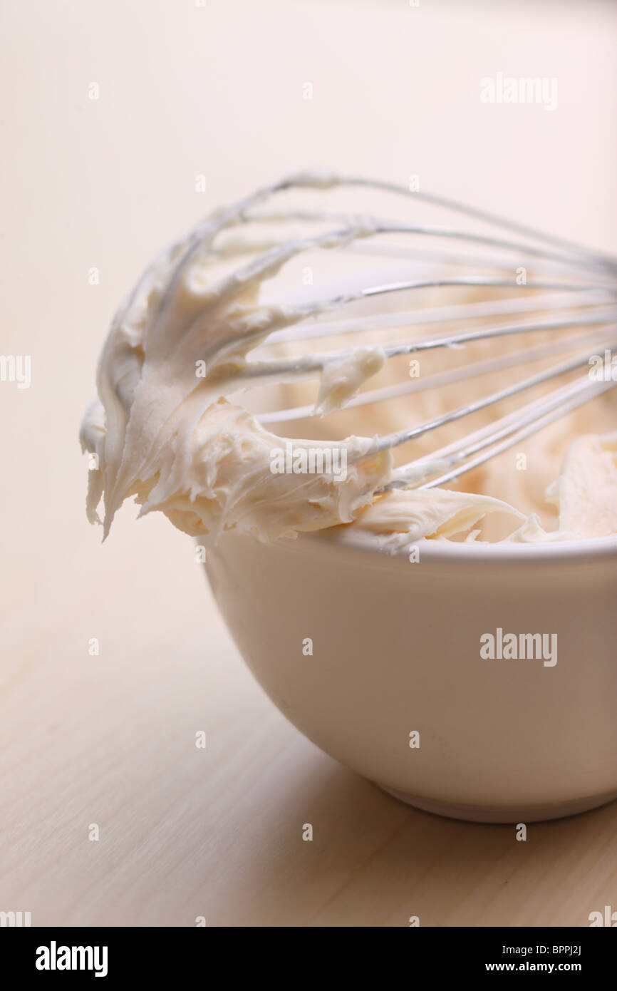 Wire whisk with frosting - Stock Image