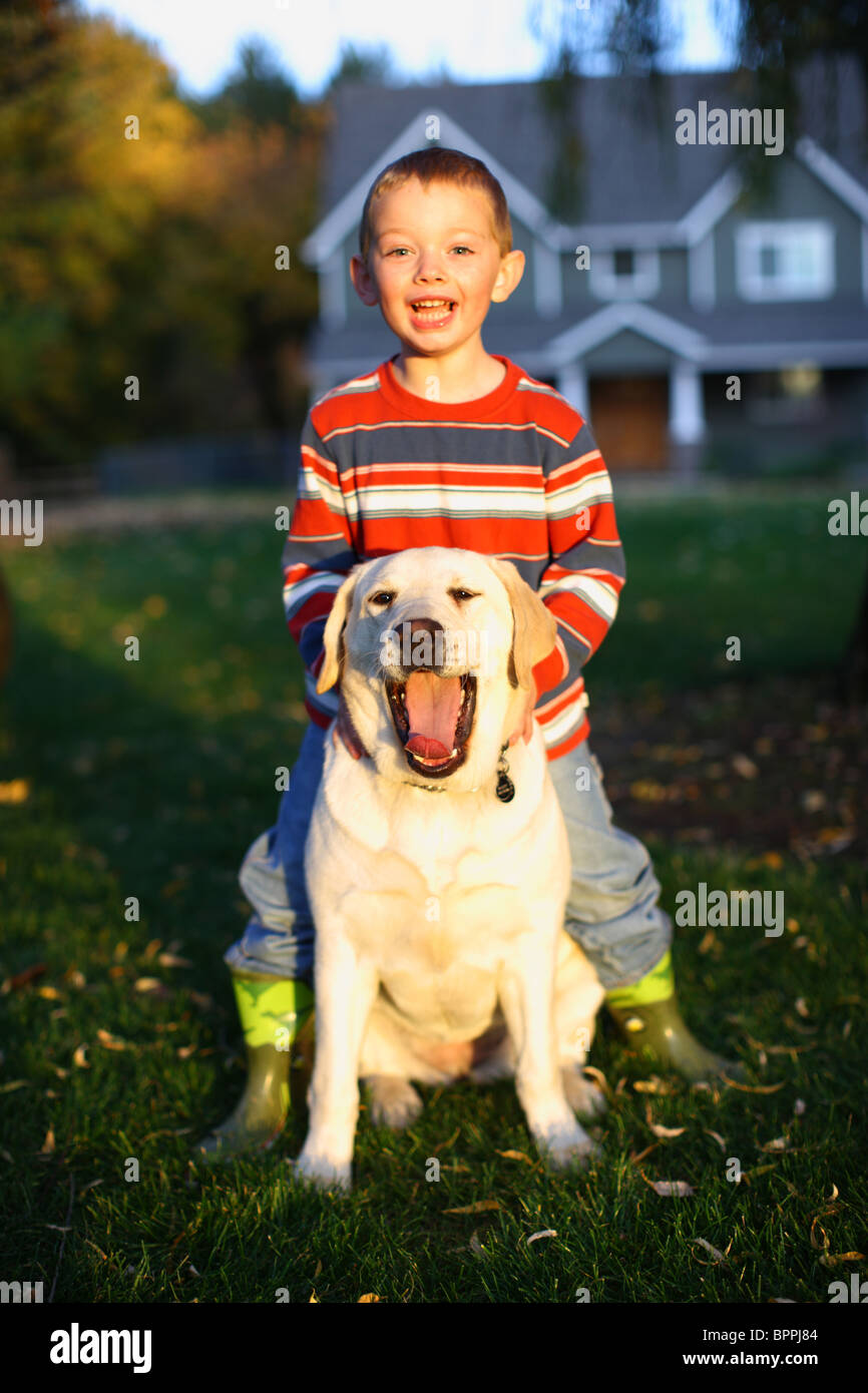 Young boy and pet dog - Stock Image
