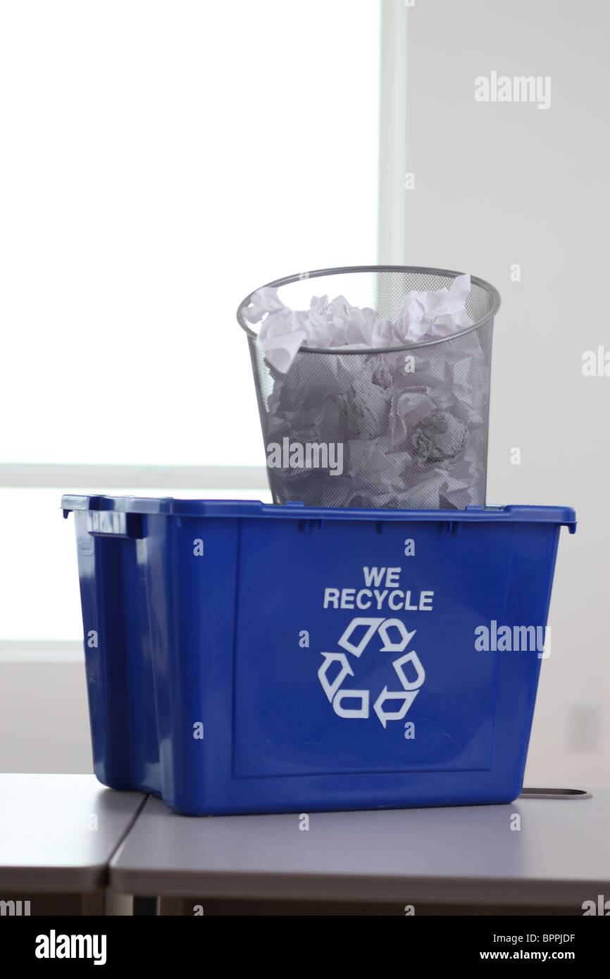 Recycle bin in office with garbage can - Stock Image