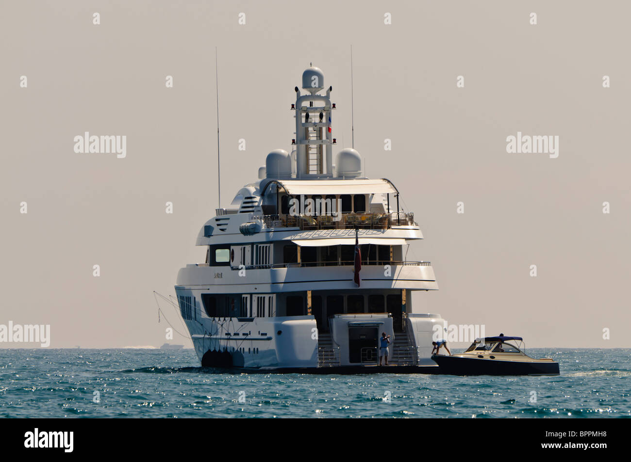 """Superyacht """"April Fool"""" and tender boat anchored in the Mediterranean Sea Stock Photo"""