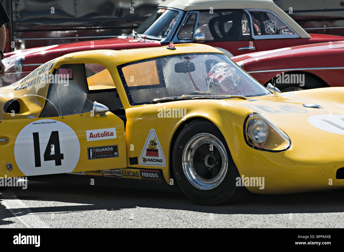 Yellow Chevron B8 Sports Race Car in Paddock at Oulton Park Motor Racing Circuit Cheshire England United Kingdom - Stock Image