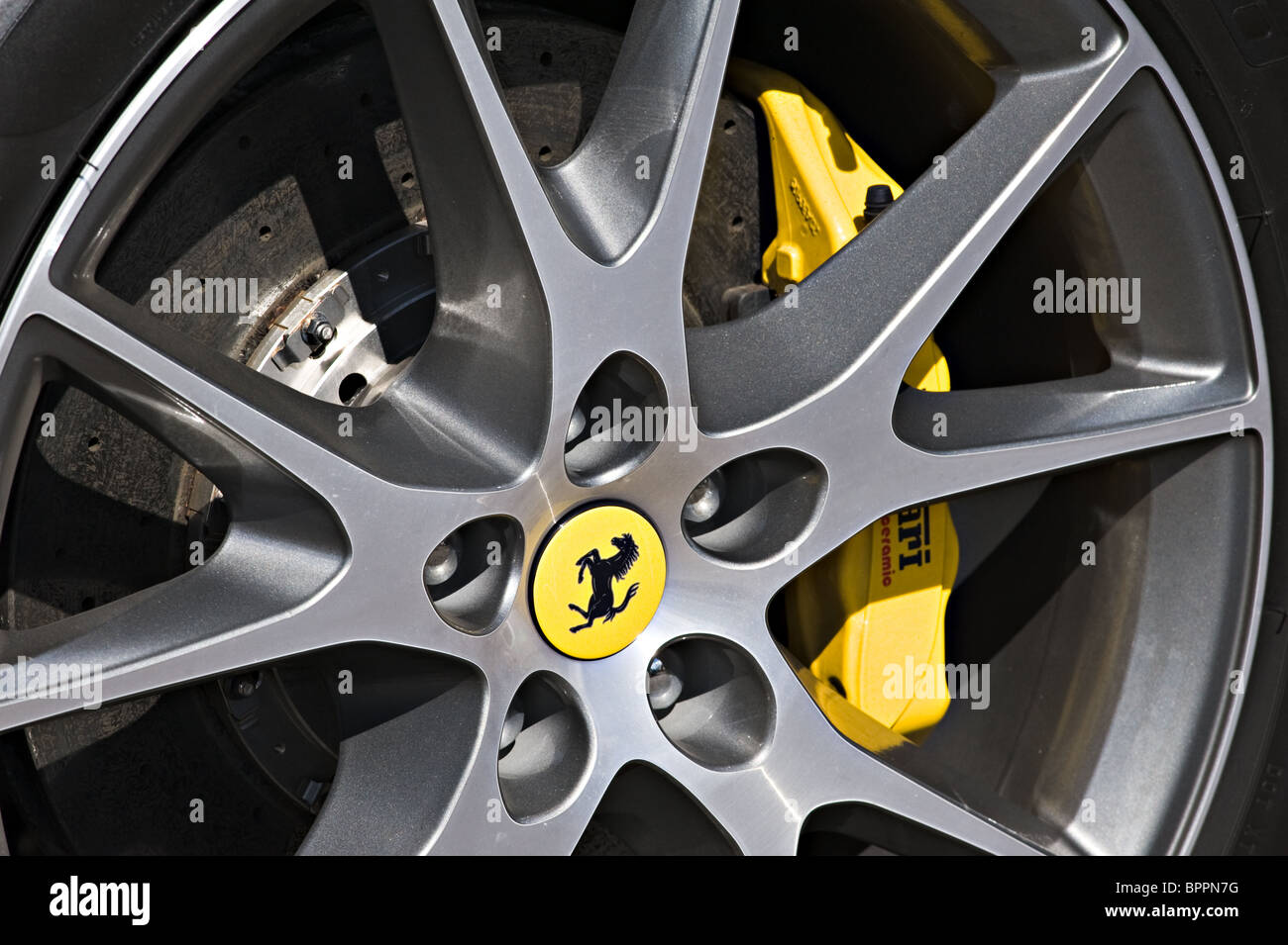 Ferrari Alloy Wheel with Prancing Horse Centre and Yellow Brake Calliper - Stock Image