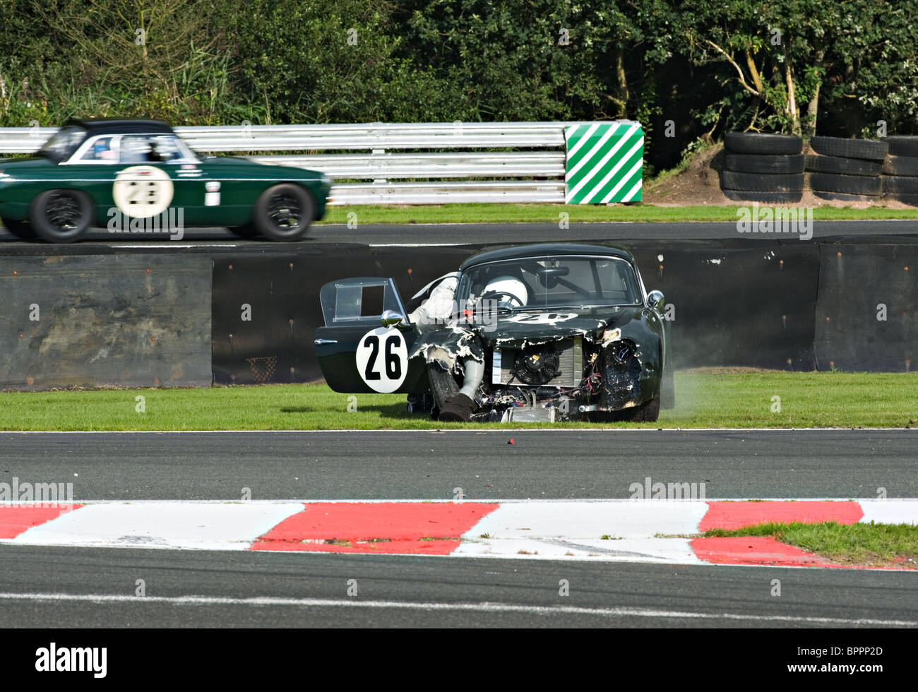 Lotus Elite Crashed at Brittens During Sports Car Race at Oulton Park Motor Racing Circuit Cheshire England United - Stock Image