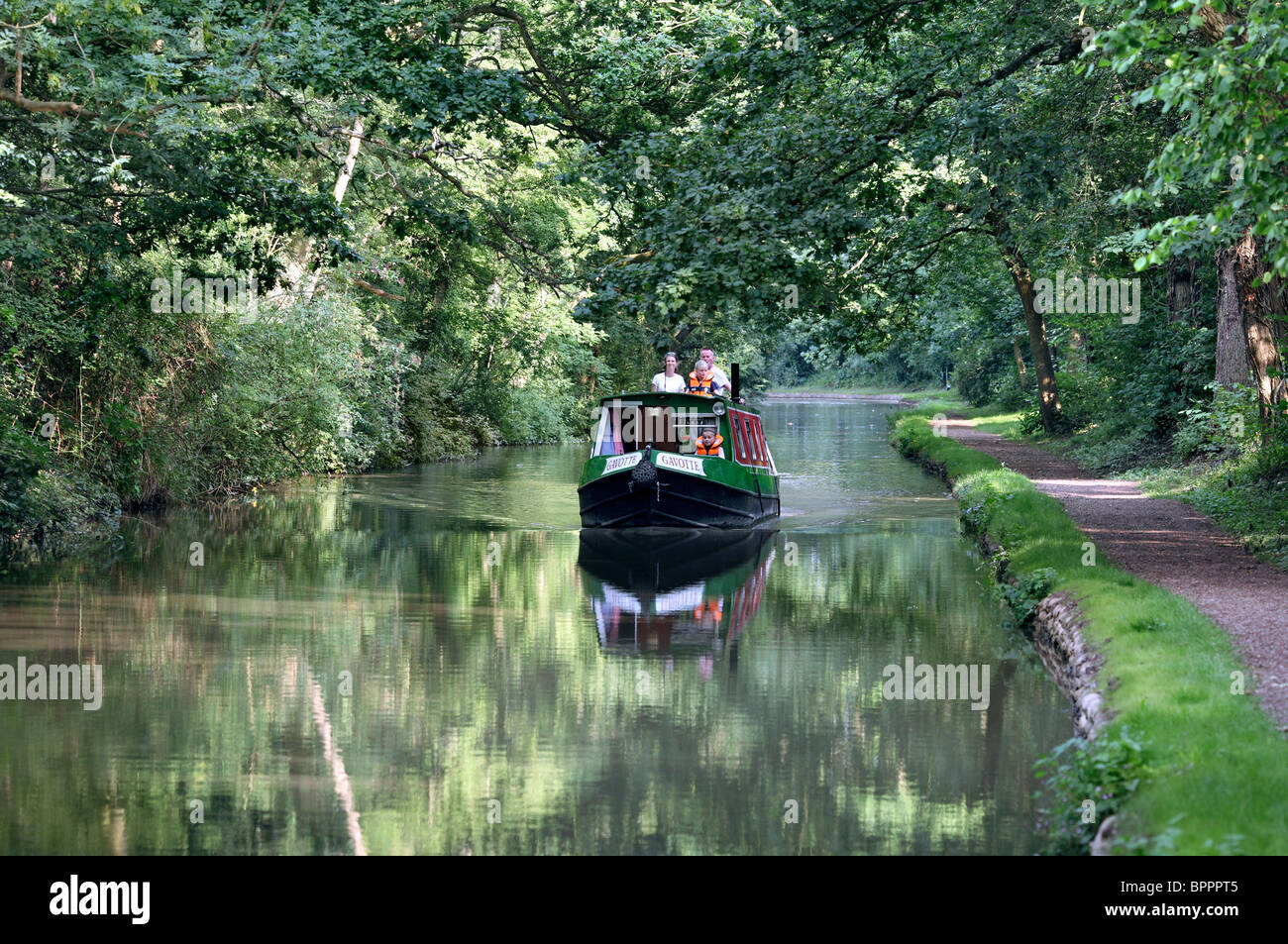 A narrowboat on the Oxford Canal, near Brinklow, Warwickshire. - Stock Image