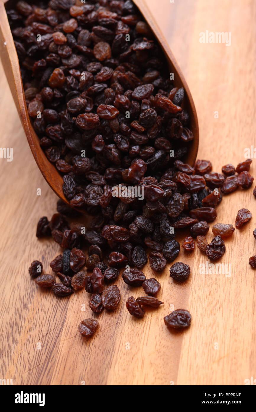 Scoop full of raisins - Stock Image