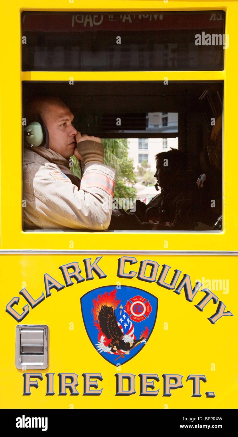 A Clark County fireman in his firetruck, Las Vegas Nevada USA - Stock Image