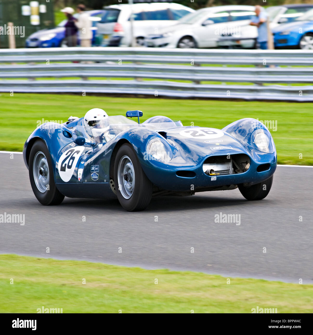 Lister Jaguar Sports Racing Car in Trophy Race at Oulton Park Motor Race Circuit Cheshire England United Kingdom - Stock Image