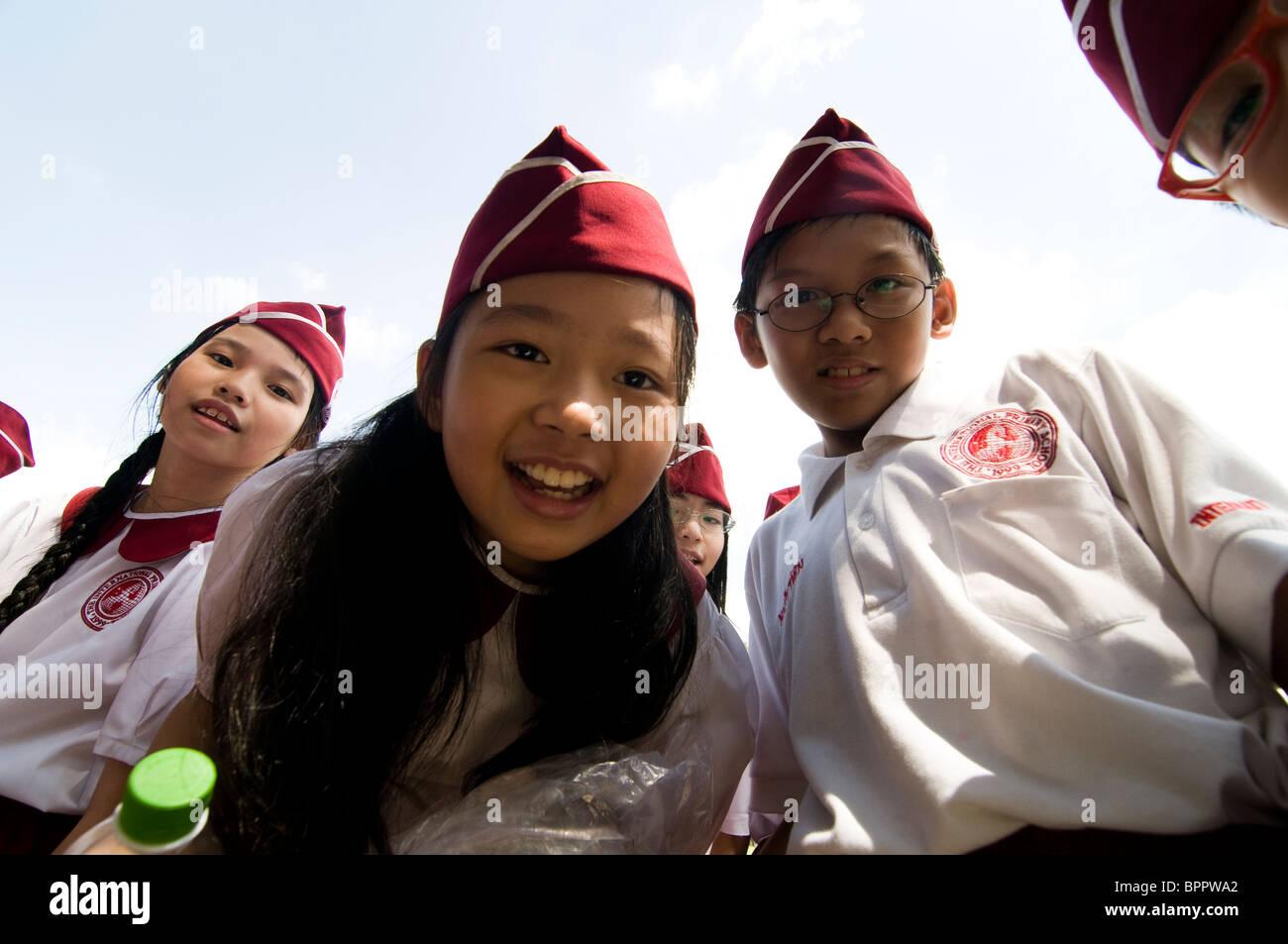 Vietnamese school children dressed up in their school uniform. - Stock Image