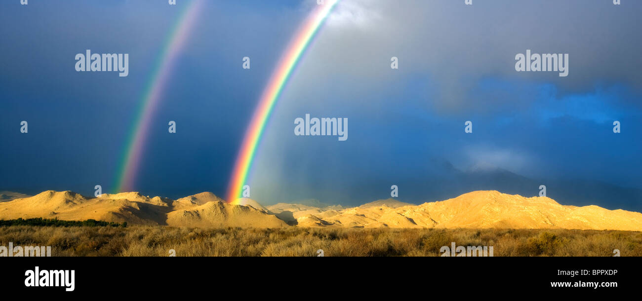 Double rainbow over Eastern Sierra Mountains near Bishop, California - Stock Image