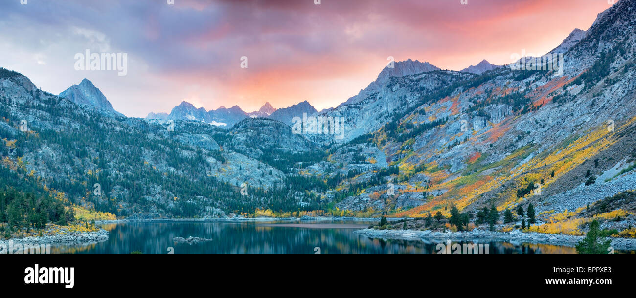 Lake Sabrina at sunset with fall colored aspens. Inyo National Forest. California - Stock Image