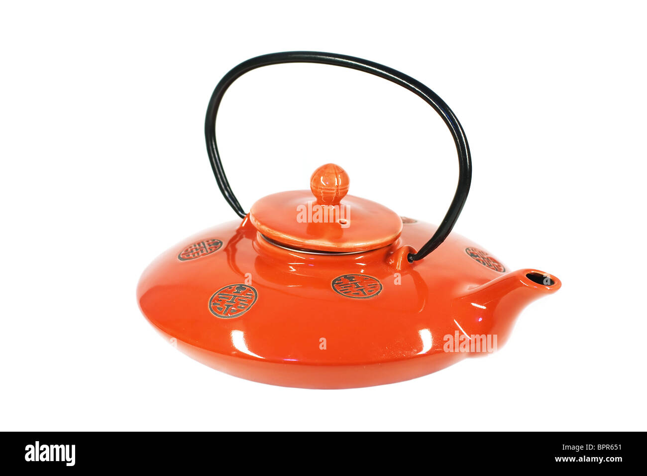 Red Chinese teapot isolated on white background. - Stock Image