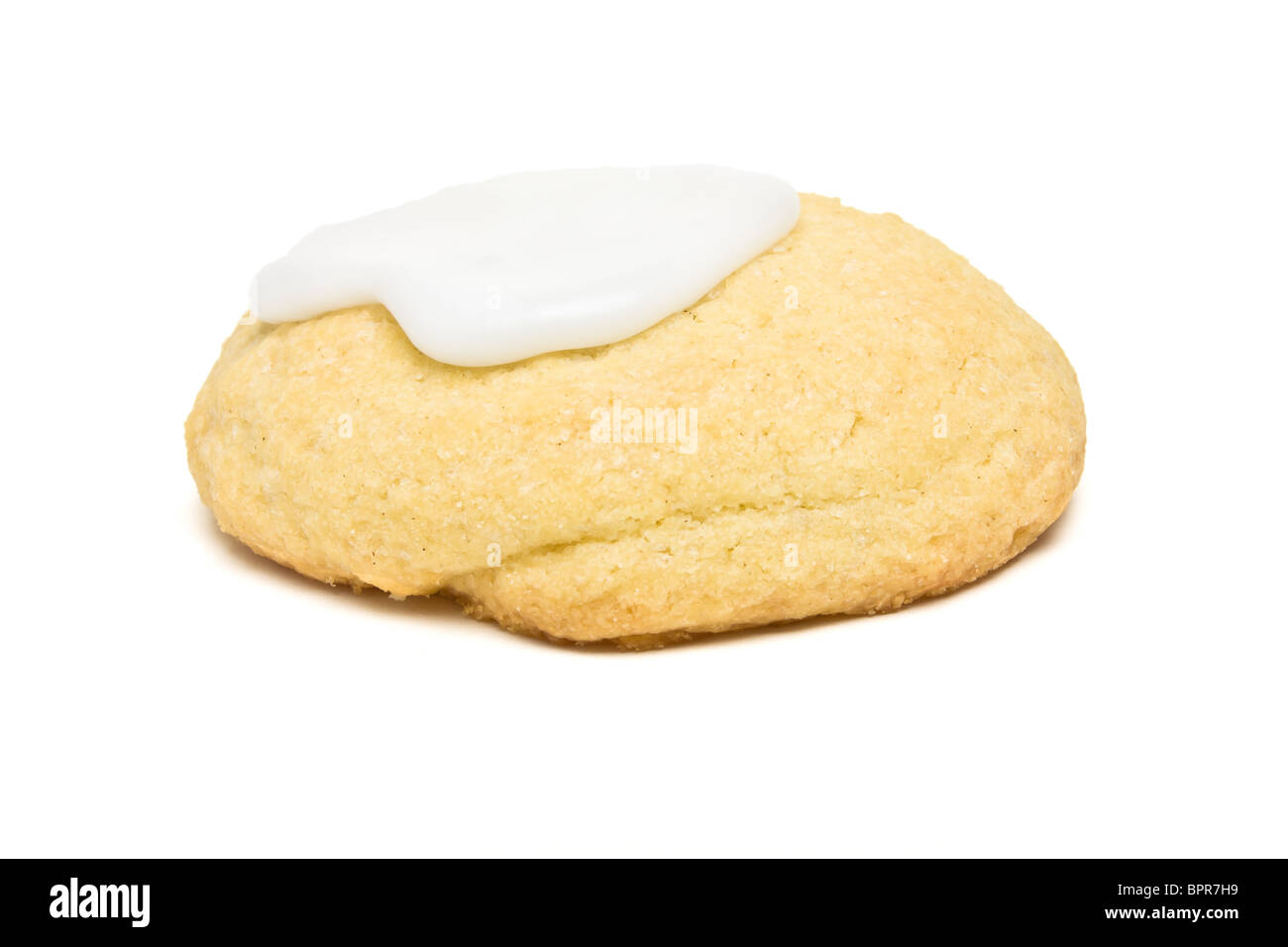 Home Baked Biscuit with white icing isolated on white. - Stock Image