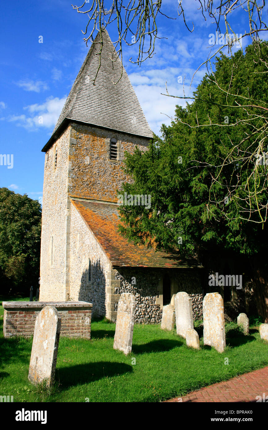 St Peter church in Rodmell with its square tower, pyramidal cap and flint walls typical of Sussex, england Stock Photo