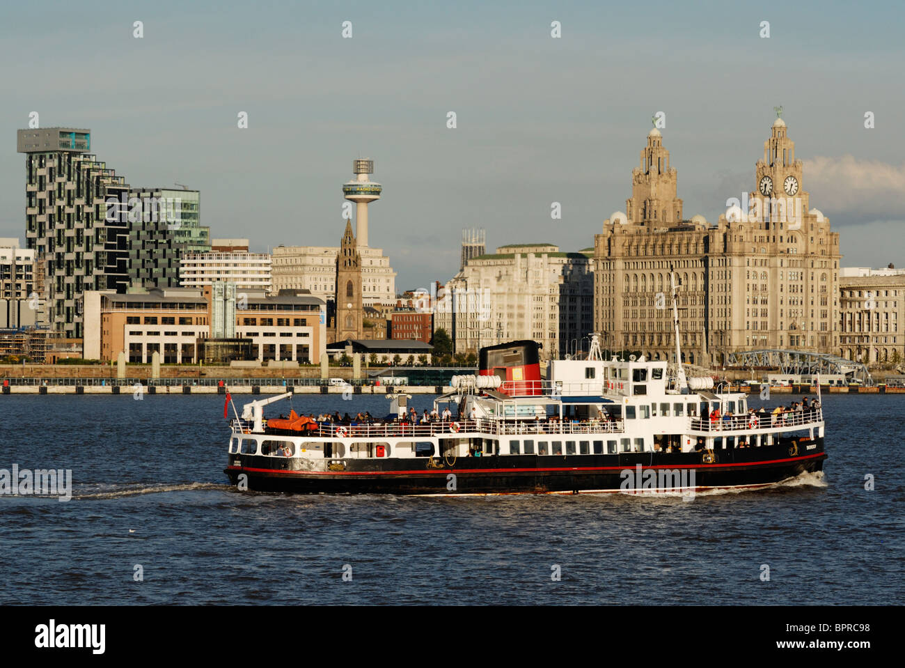 Ferry crossing the River Mersey in front of Pier Head. - Stock Image