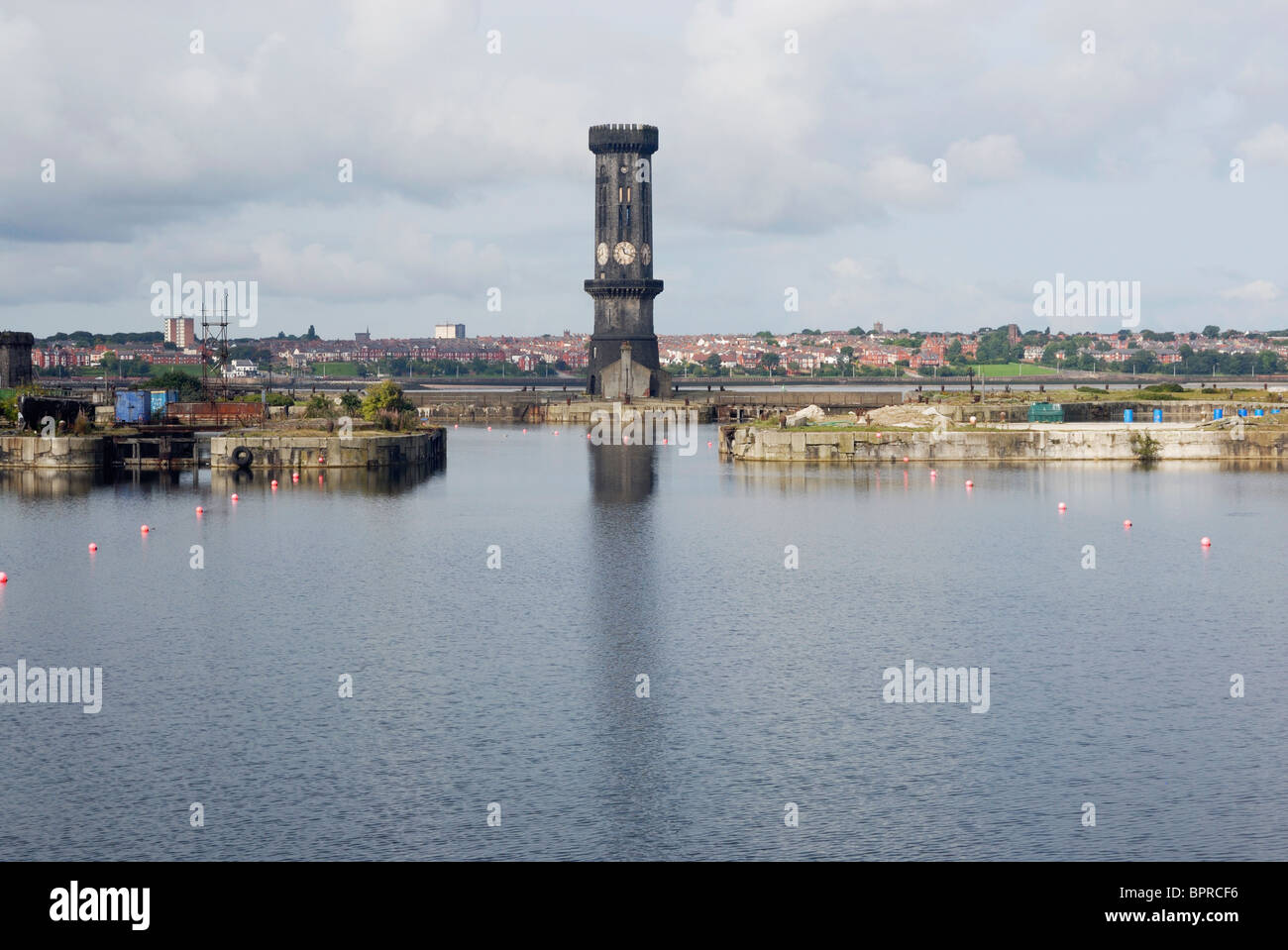 Jesse Hartley's hexagonal clock tower in Liverpool Docks with Birkenhead / Wallasy in background. - Stock Image