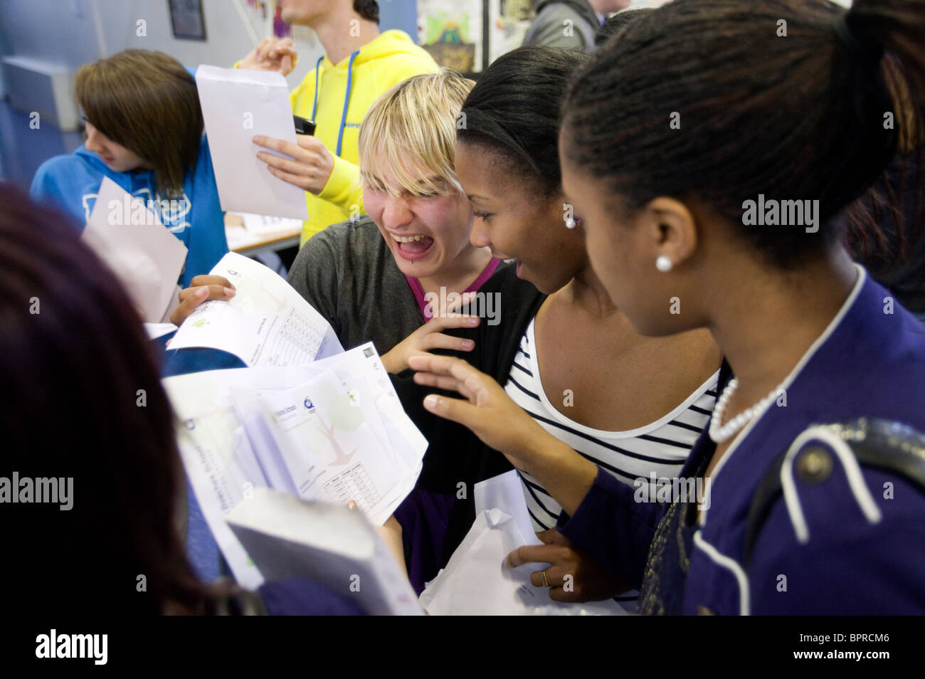 Pupils at Perry Beeches school in Birmingham celebrate their GCSE exam results. - Stock Image