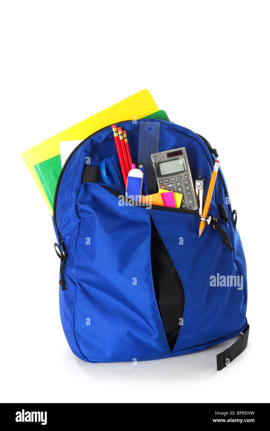 Backpack full of back to school supplies studio isolated on white background - Stock Image