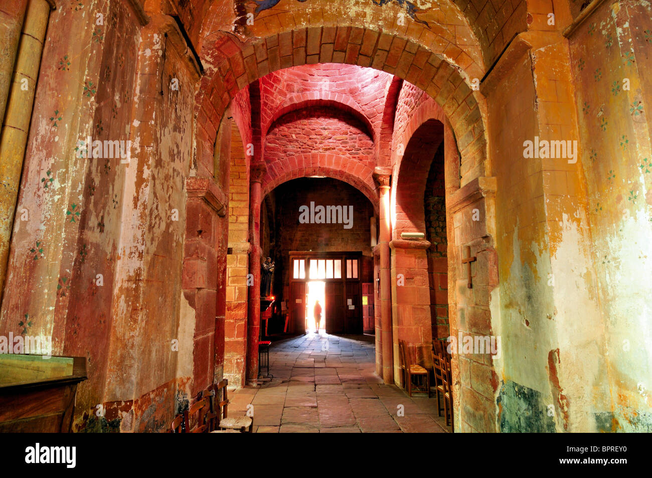 France: Interior of medieval parish church St. Pierre in Collonges-a-Rouge - Stock Image