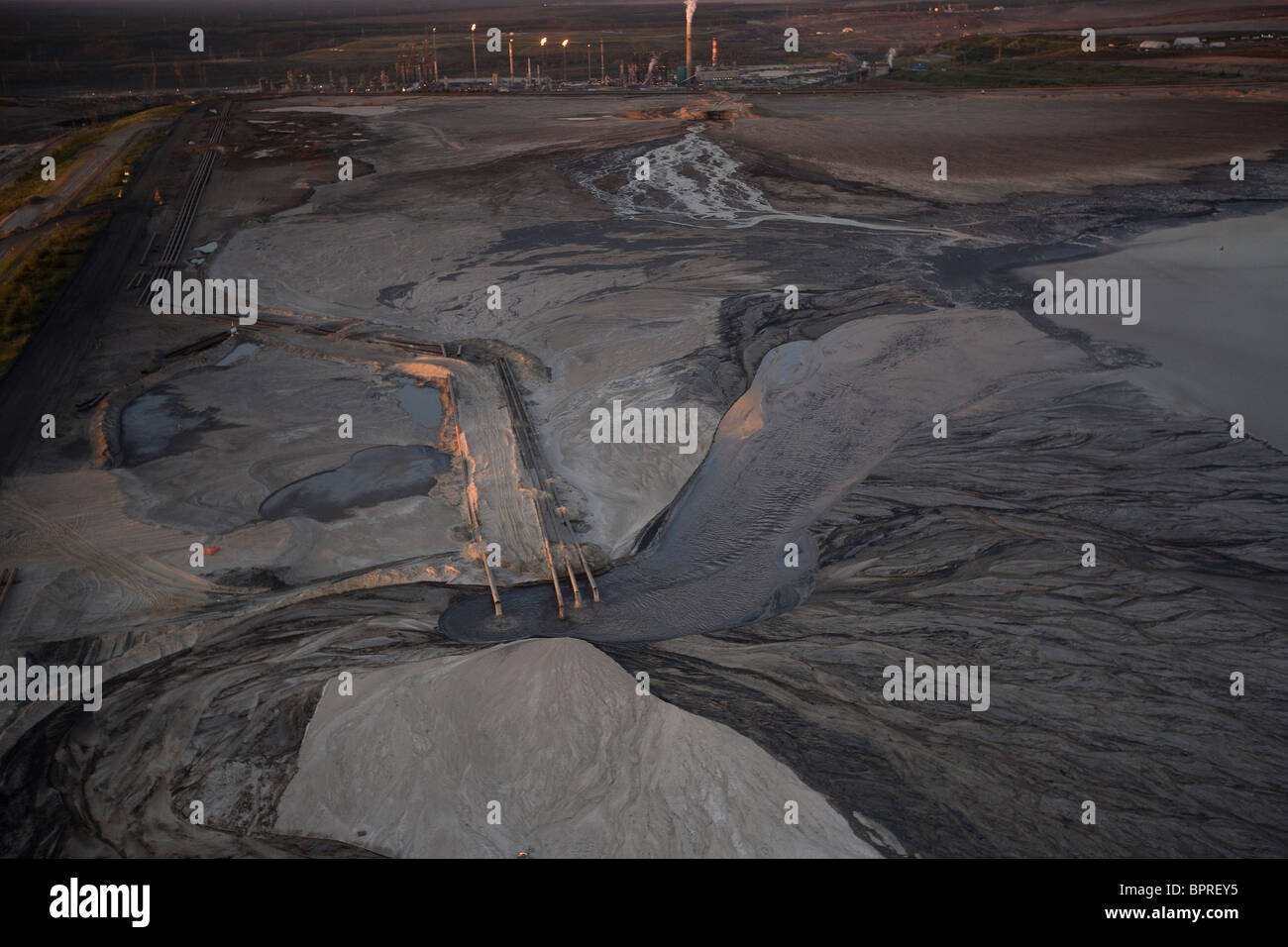 Tailings Pond outflow pipes from the Bitumen Separation Plant, Suncor Millenium oil sands mine north of Fort McMurray, - Stock Image