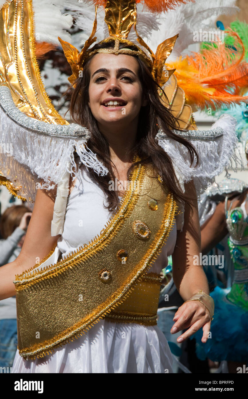 Woman dancing in costume at the Notting Hill Carnival - Stock Image