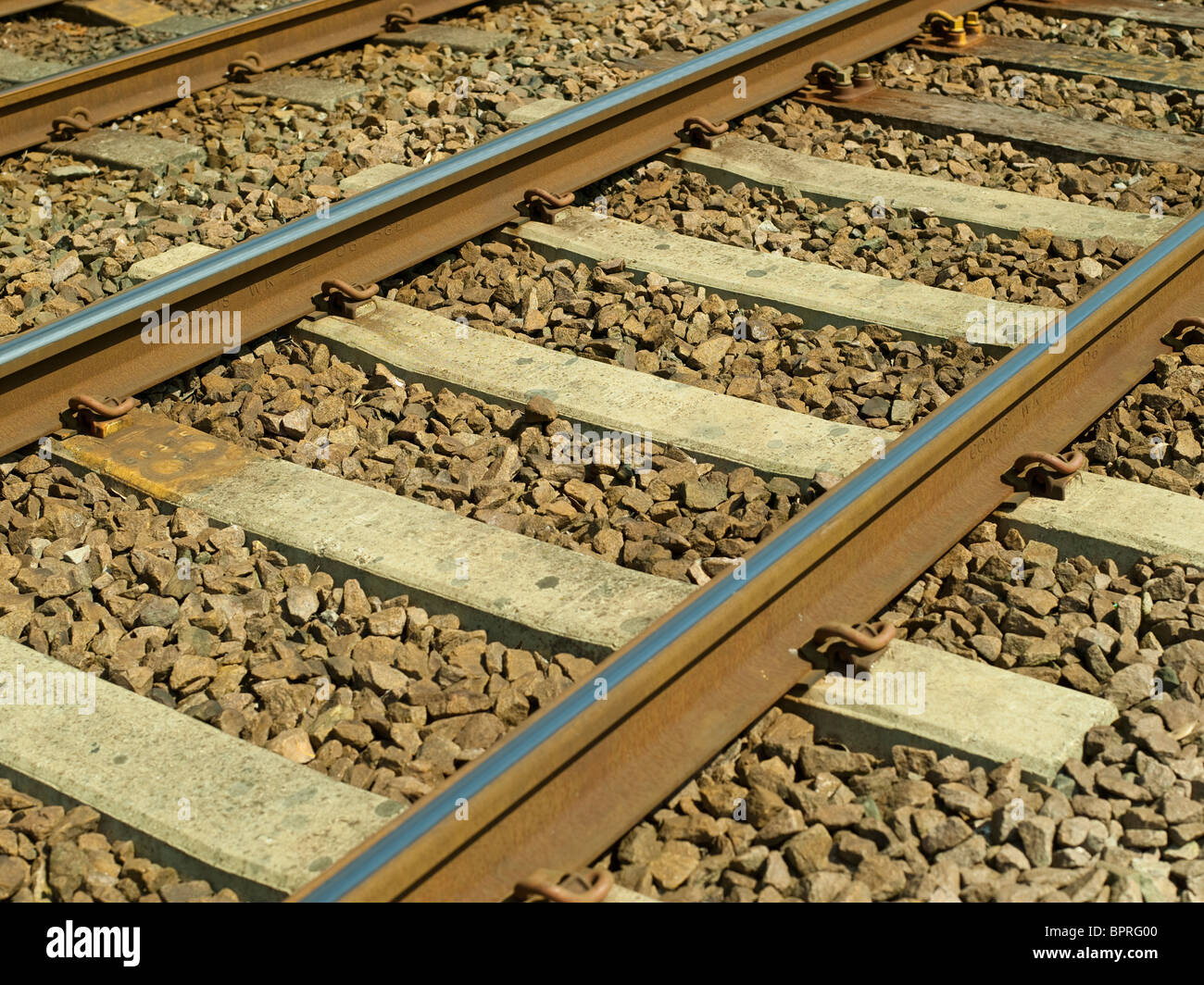 Close up of railway lines and sleepers England UK United Kingdom GB Great Britain - Stock Image