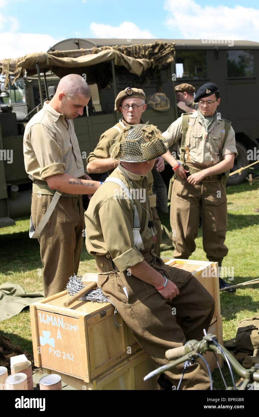 WW2 Reenactment male members wearing the uniform of men from