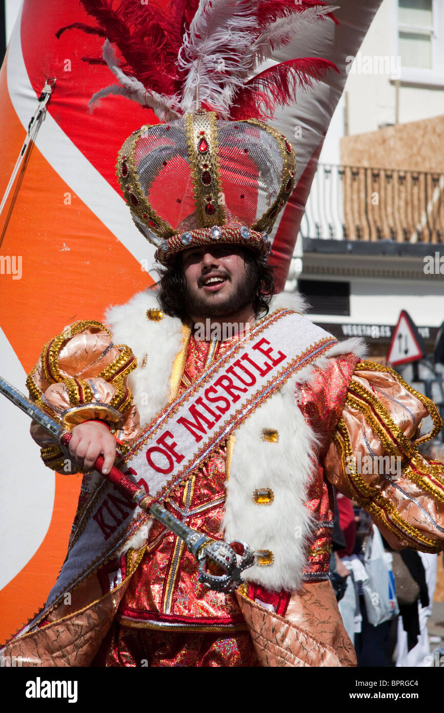 Man wearing a King Of Misrule sash at the Notting Hill Carnival - Stock Image