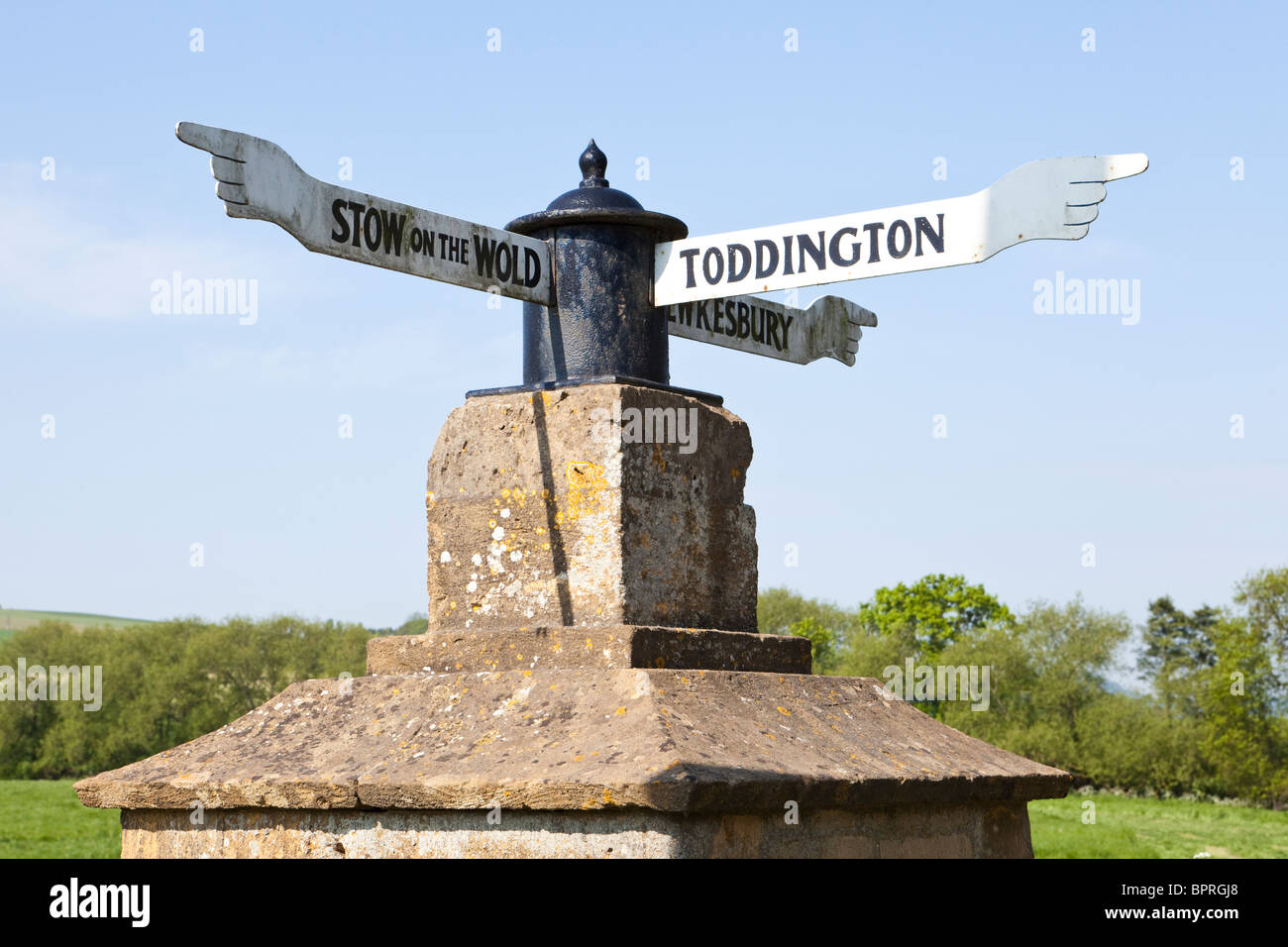 Eighteenth century fingerpost beside the B4077 Stow to Tewkesbury road at Toddington, Gloucestershire - Stock Image