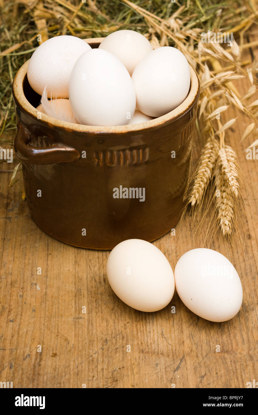 Eggs in old bowl - Stock Image