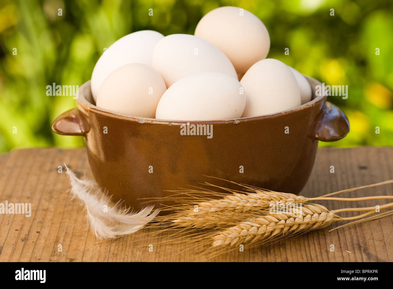 Eggs in old bowl with shallow focus - Stock Image