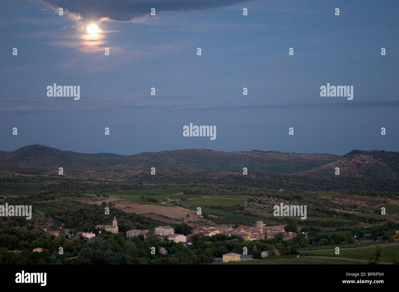 Full Moon over French village Loiras du Bosc in Herault Languedoc France - Stock Image