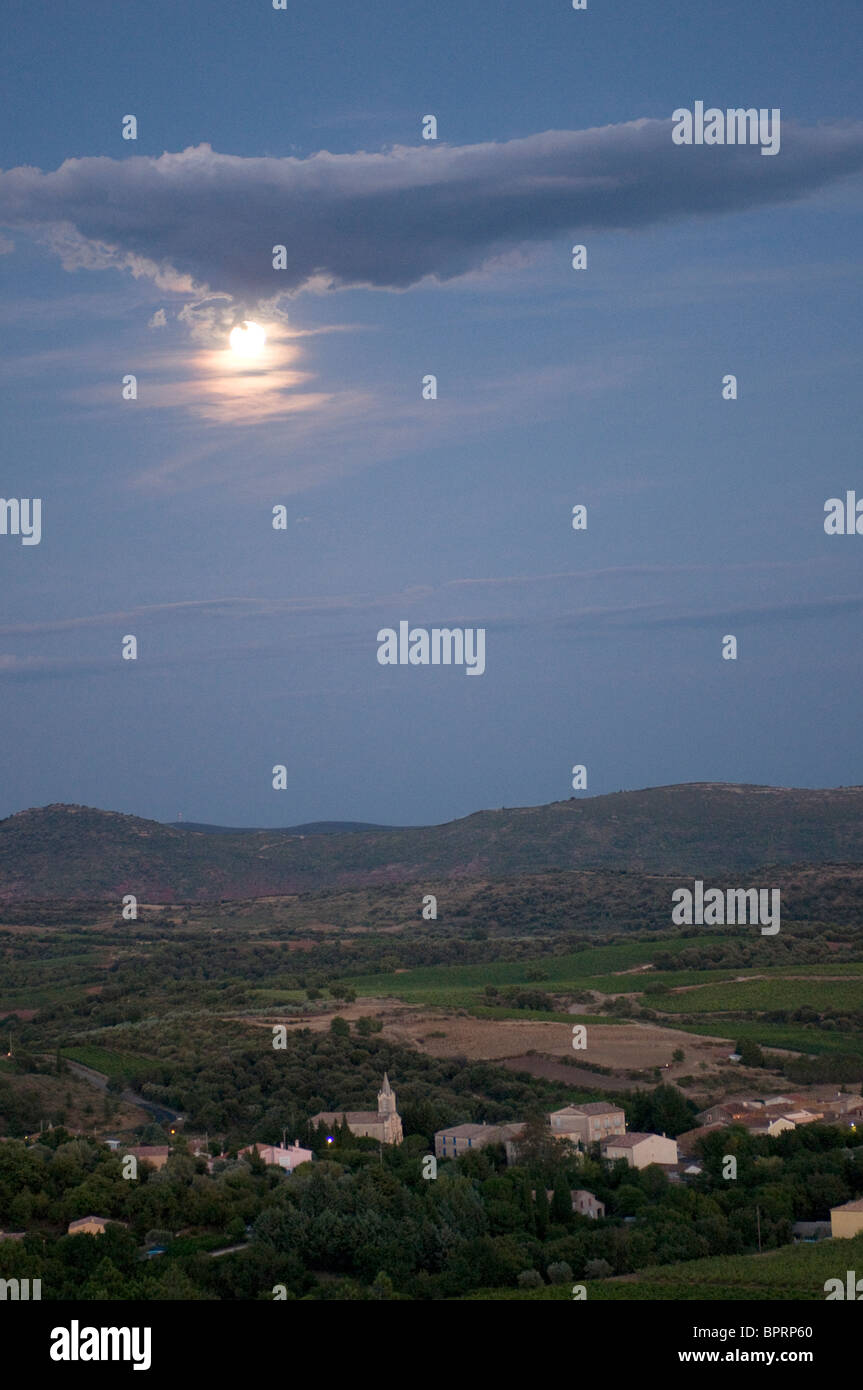 Full moon over village of Loiras du Bosc in Herault Languedoc South of France - Stock Image