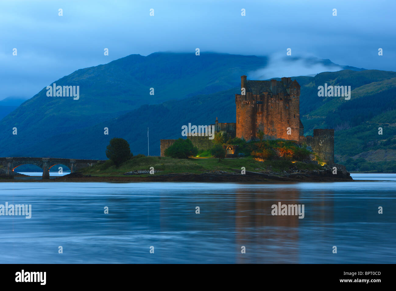 Famous Eilean Donan Castle at the blue hour after sunset, Scotland - Stock Image