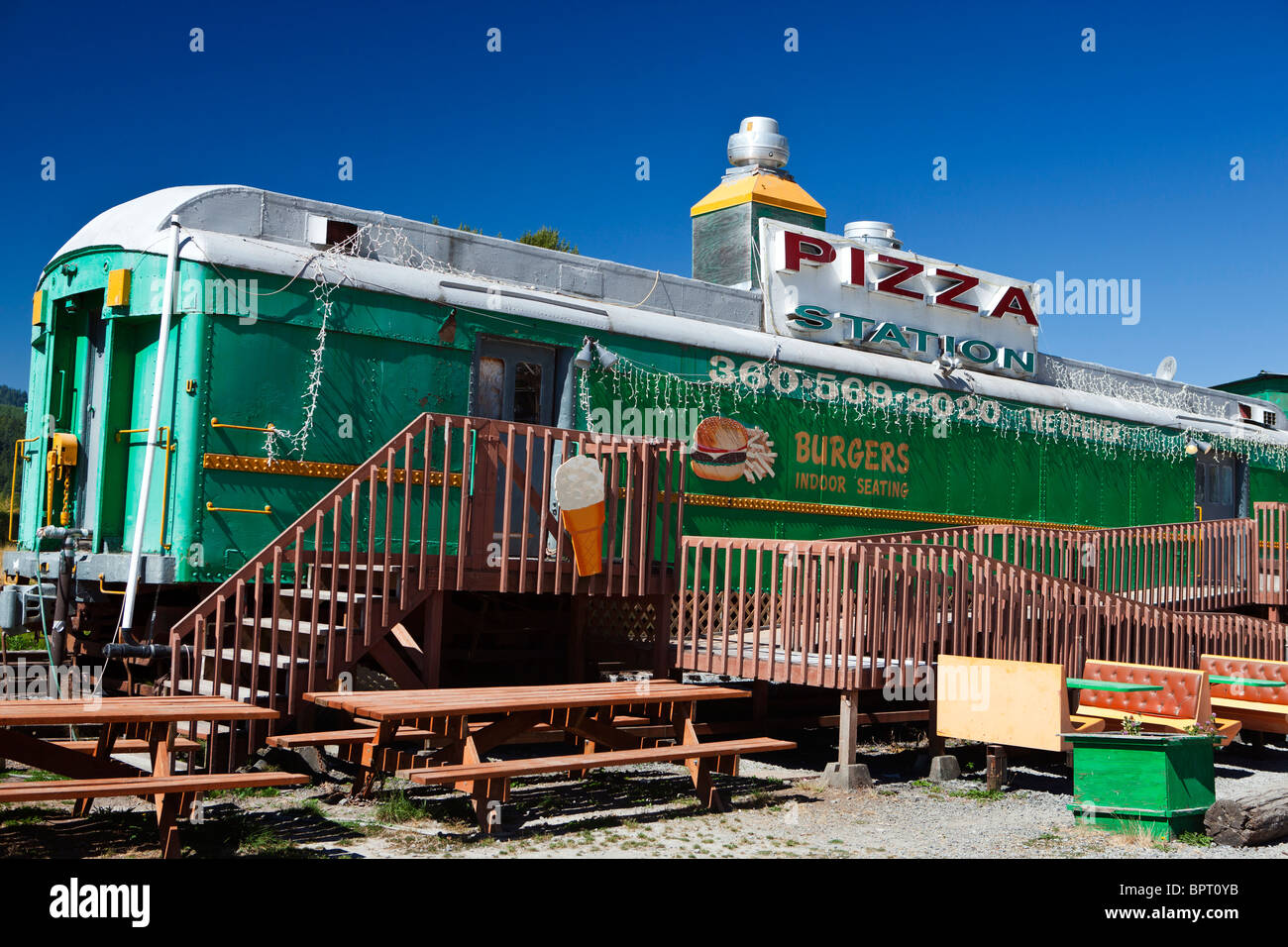 Pizza and burger restaurant made out of converted railroad car, Elbe, Washington, United States of America - Stock Image
