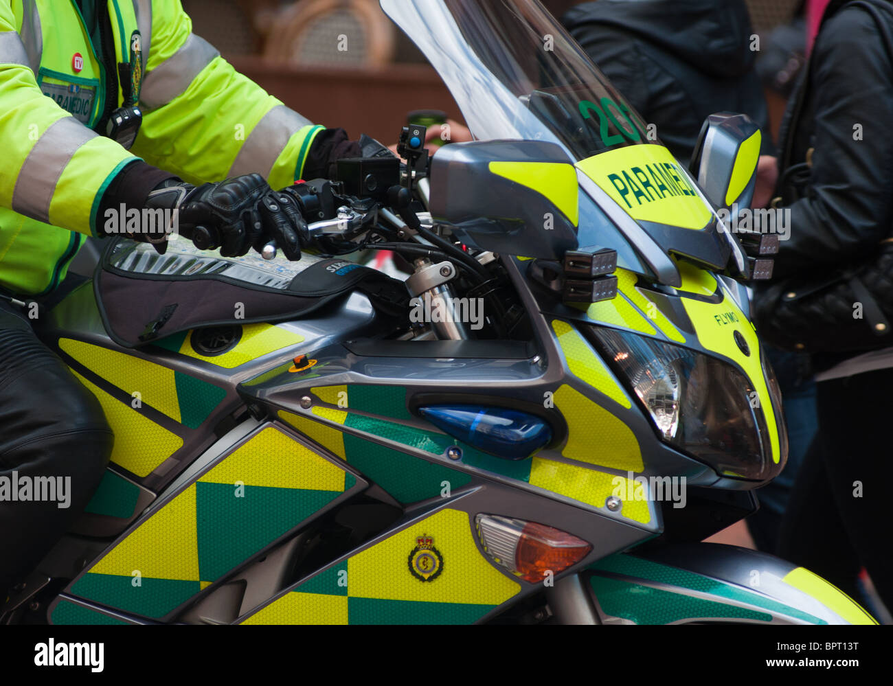 A paramedic on a motorbike, seem in Birmingham city centre, England - Stock Image