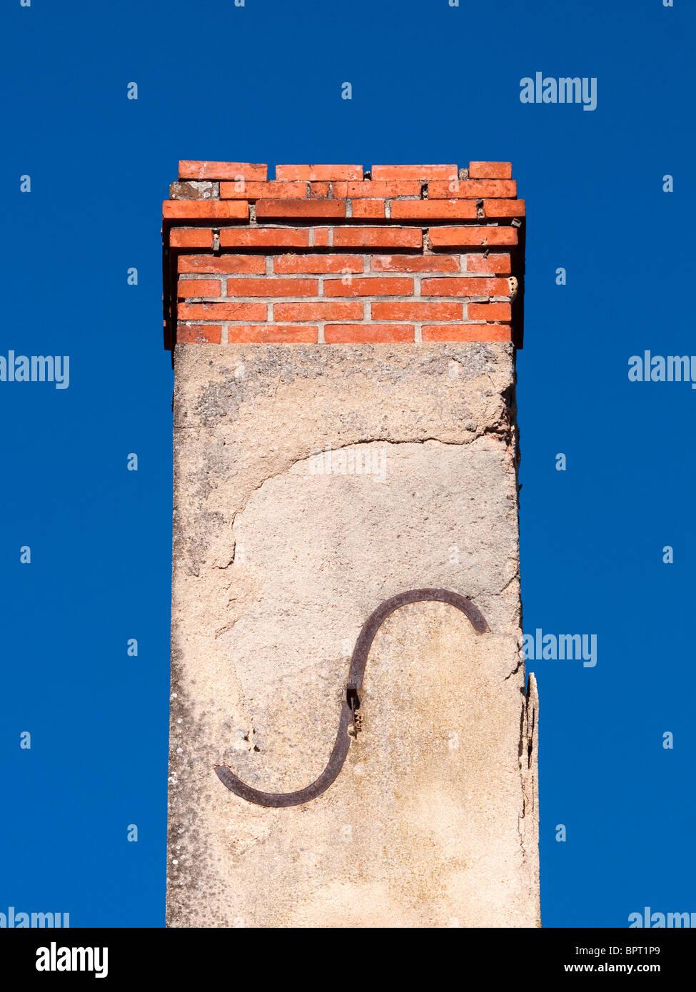 Iron letter 'S' on brick chimney stack - Indre-et-Loire, France. - Stock Image