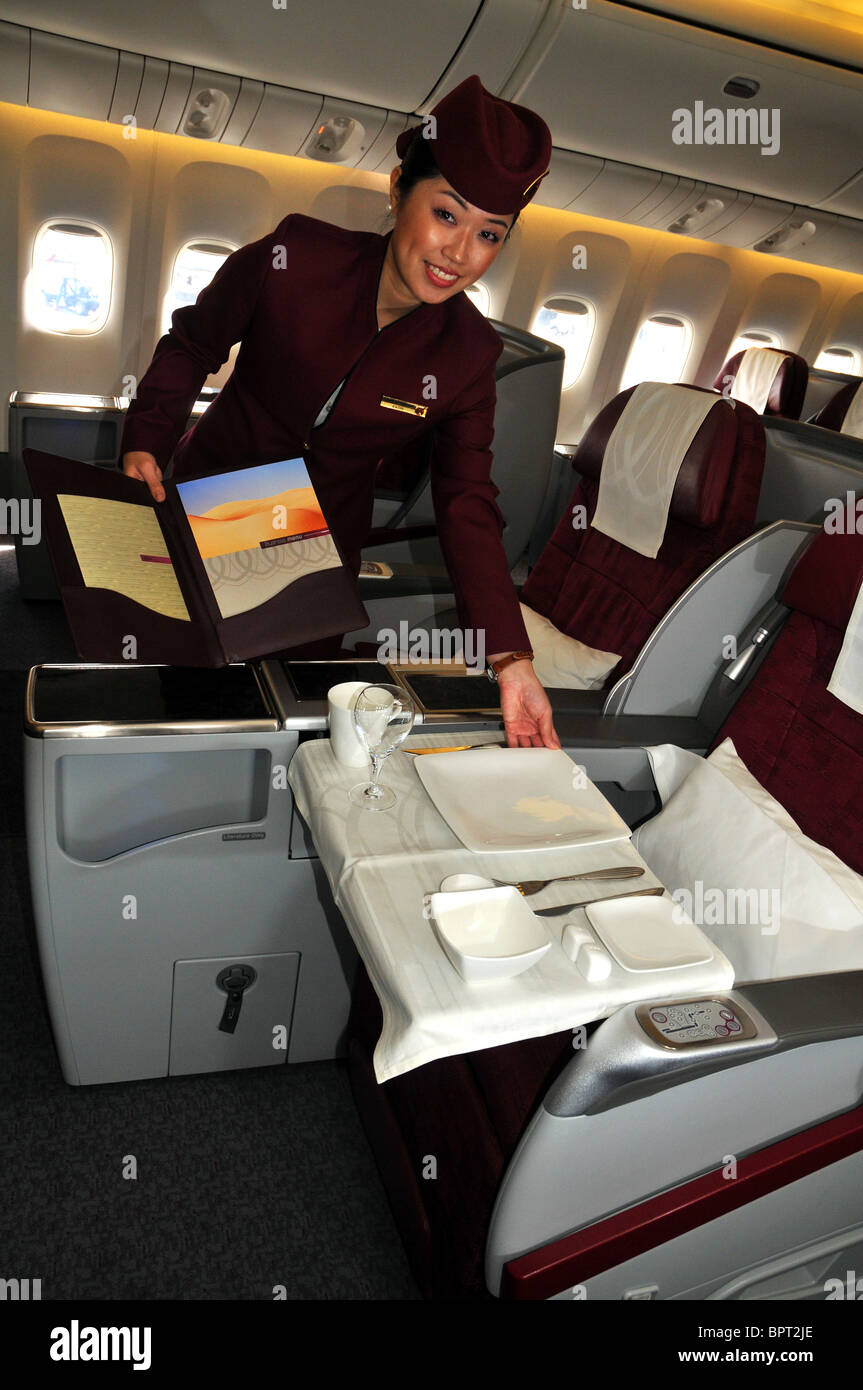 Qatar airlines stewardess in first and business class - Stock Image