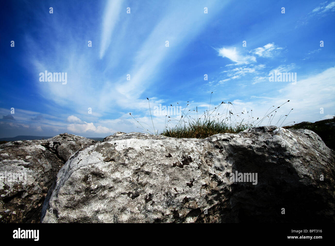 Attractive cloud pattern at the summit of a limestone cliff in Malham, North Yorkshire - Stock Image