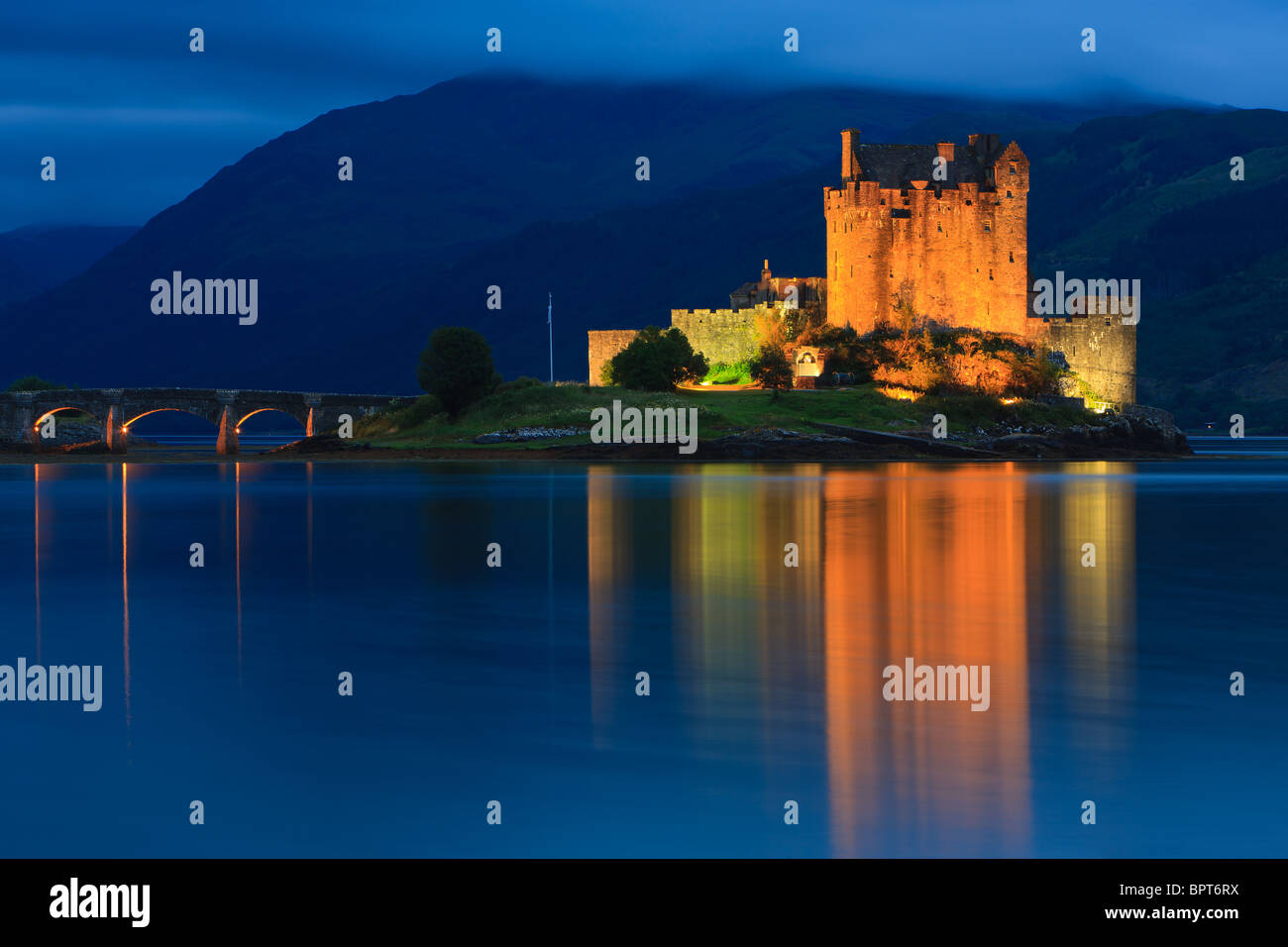 Famous Eilean Donan Castle at the blue hour after sunset, Scotland - Stock Image