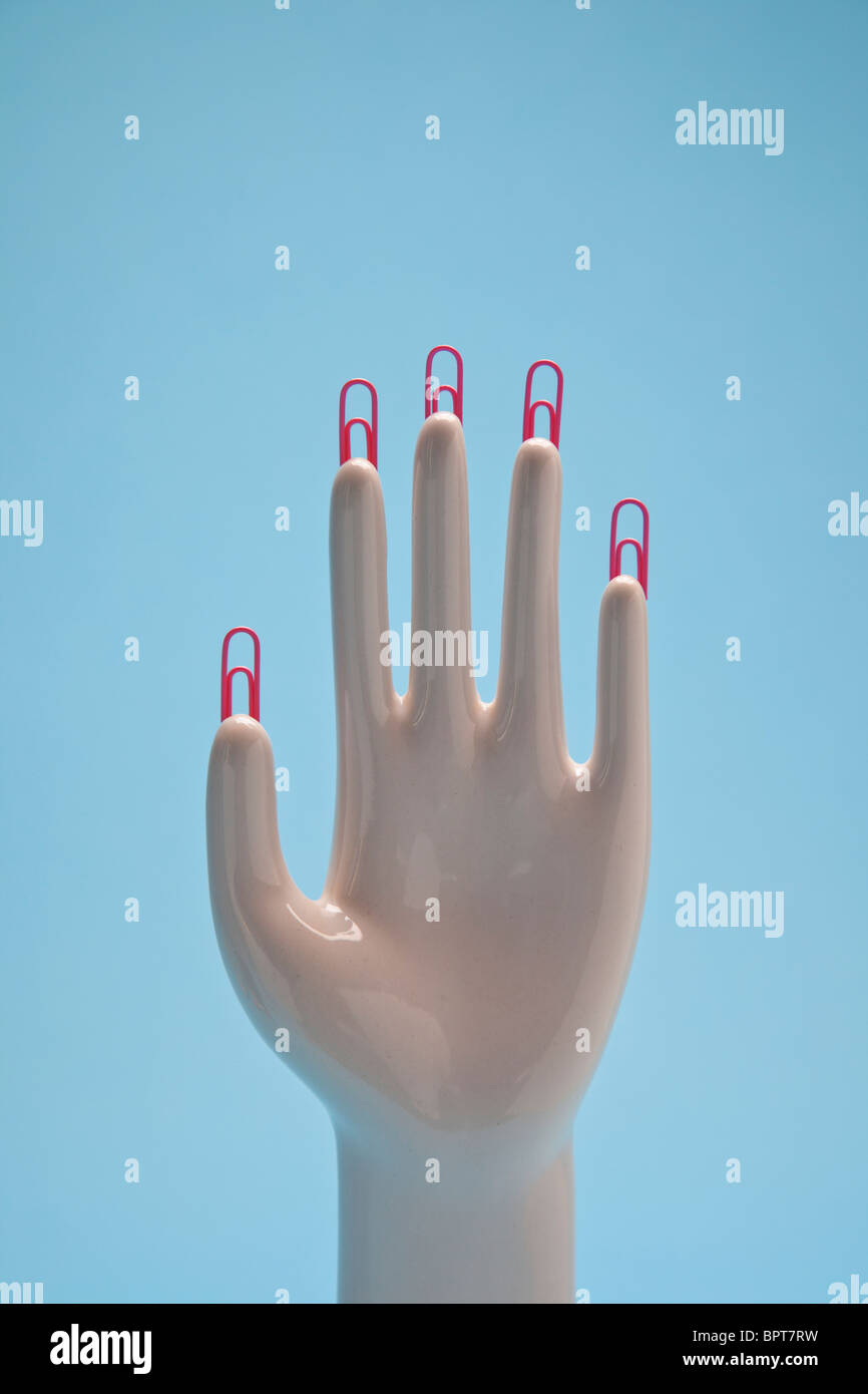 hand with paper clip finger nails - Stock Image