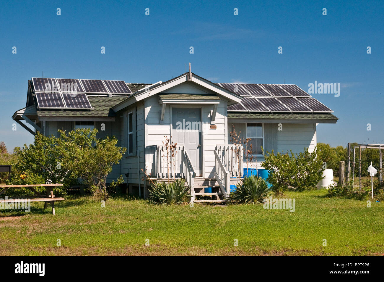 Beach house with photovoltaic solar panels - Stock Image