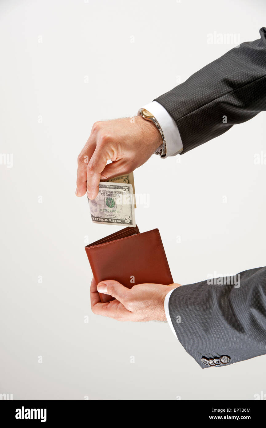 business man takes money out of his wallet - Stock Image