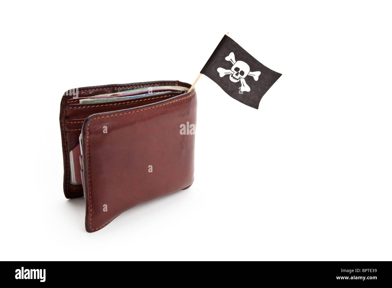 Pirate Flag and Wallet, concept of business crime - Stock Image