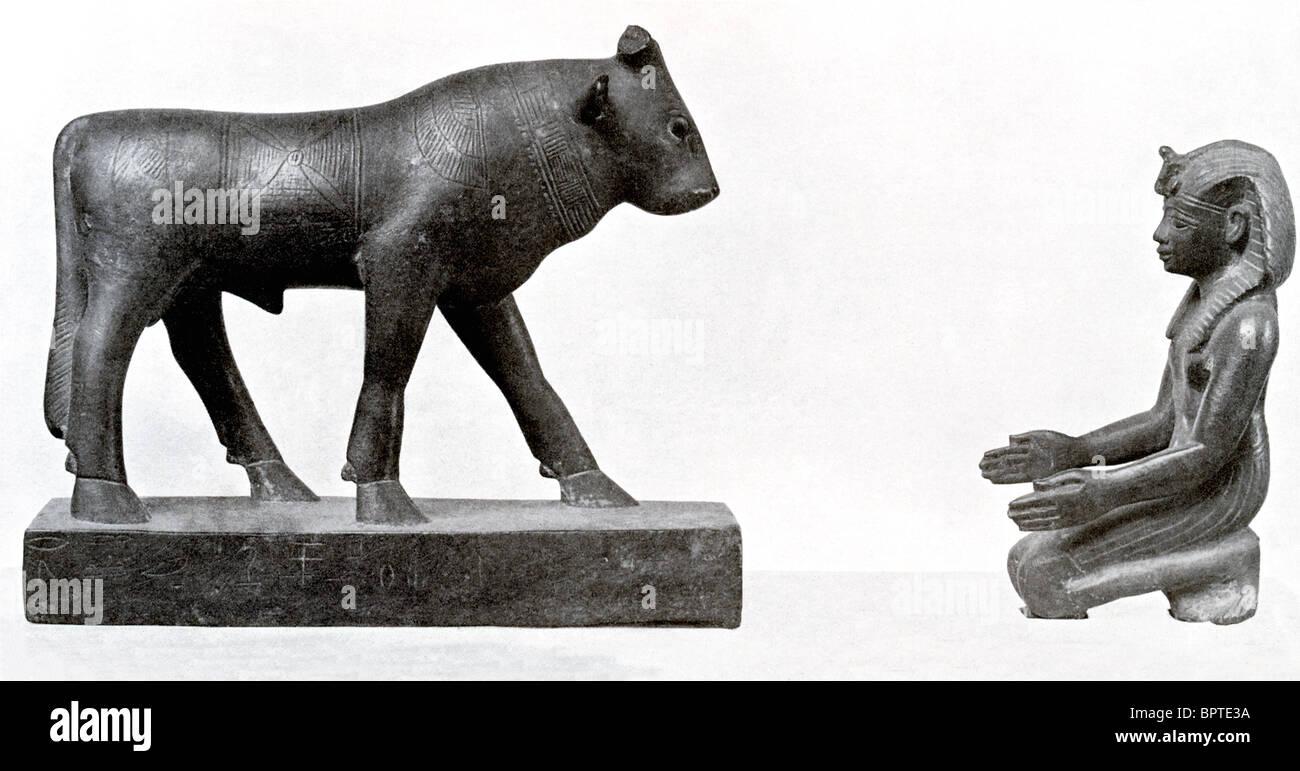An Egyptian pharaoh pays homage to the Apis bull. - Stock Image