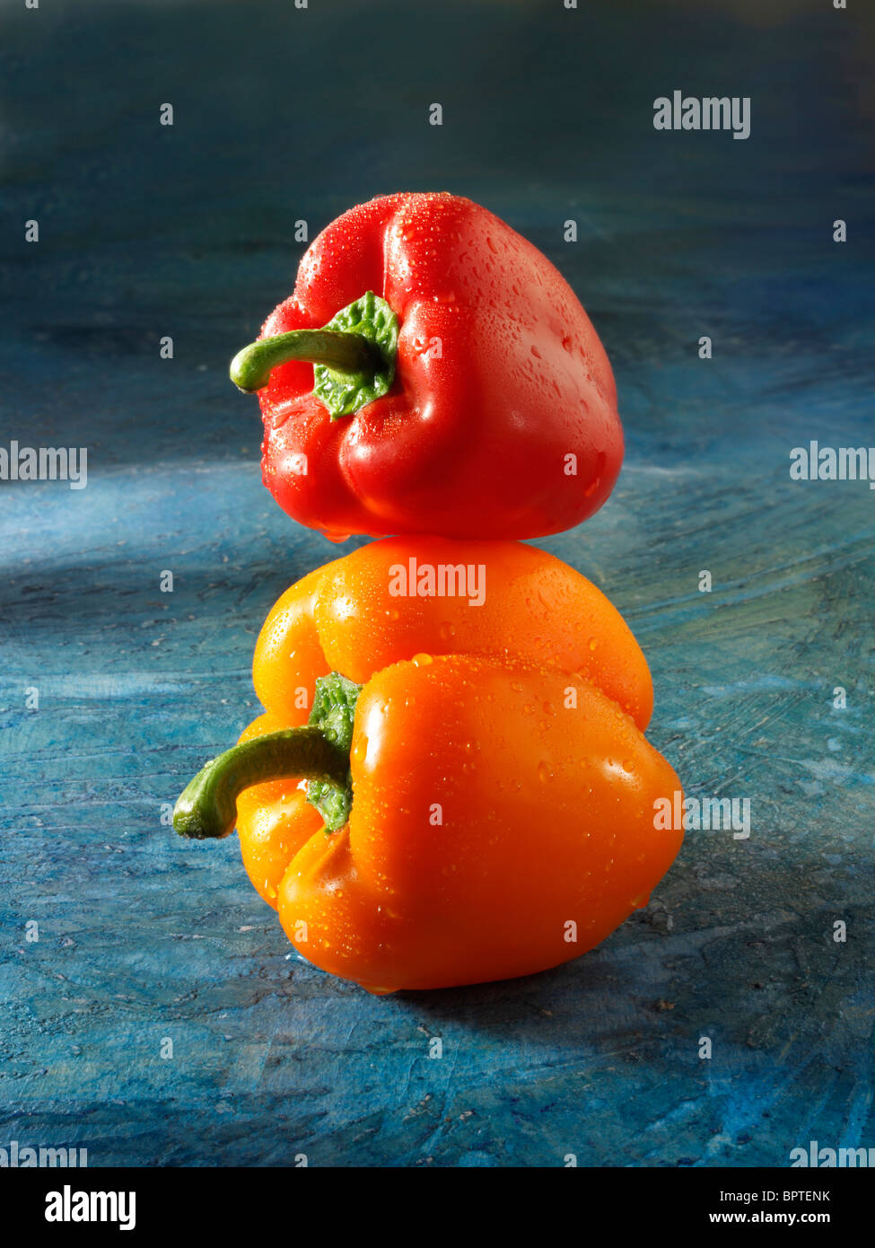 Mixed red & orange fresh bell peppers photos, pictures & images - Stock Image