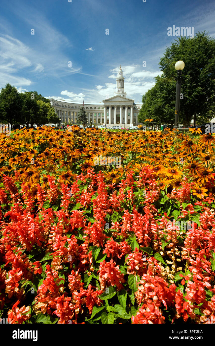 Denver City & County Building viewed from the lush flower gardens in Civic Center Park, Denver, Colorado, USA - Stock Image