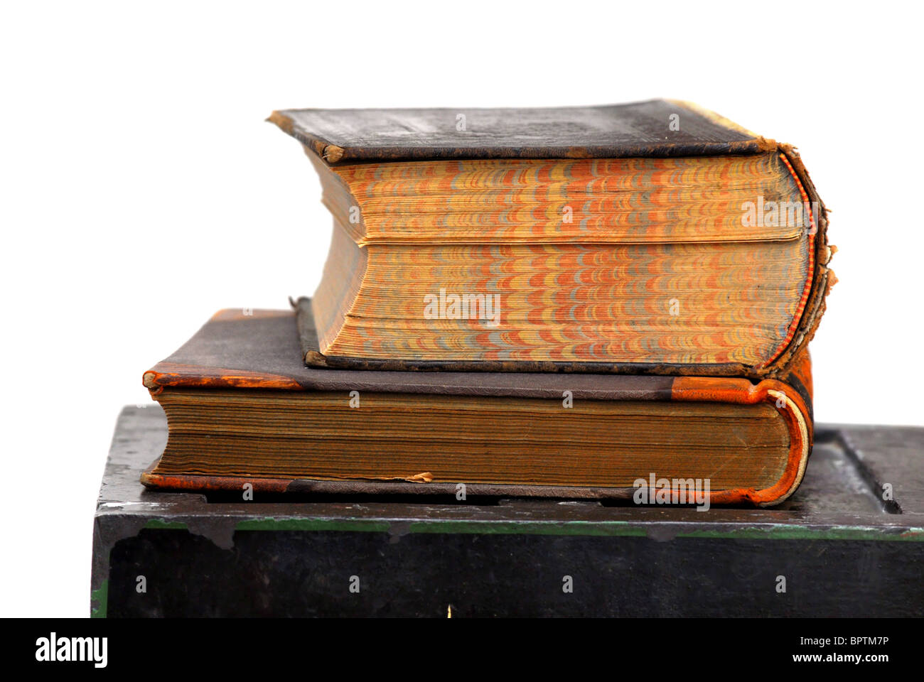 Antique books placed on an old chest - Stock Image